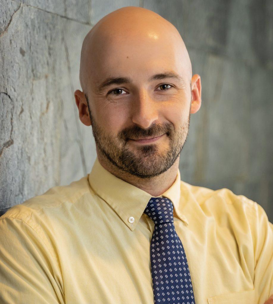 A professional head shot of Matt Fridell.